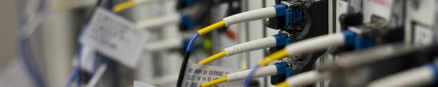 Why would carriers choose to buy used or refurbished telecoms equipment?