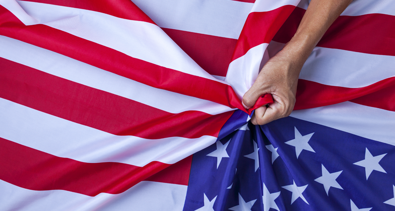 Person clutching to American flag
